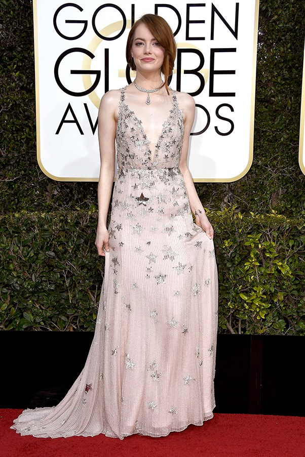 """<strong>Emma Stone in Valentino</strong><br><br> """"That hair, that shade of pink, that neckline – 50 shades of perfect. The only thing I'd scrap is the necklace, no need really."""" - Anna Lavdaras, beauty writer<br><br> """"This is hands down one of my favourite Emma Stone looks ever. The fun, motif print and plunging neckline is perfectly balanced by the muted colour palette and understated hair and makeup."""" - Natasha Harding, digital fashion writer<br><br> """"I think Emma stole the show in her encrusted blush Valentino gown! She is all class."""" - Aubree Smith, fashion office coordinator"""