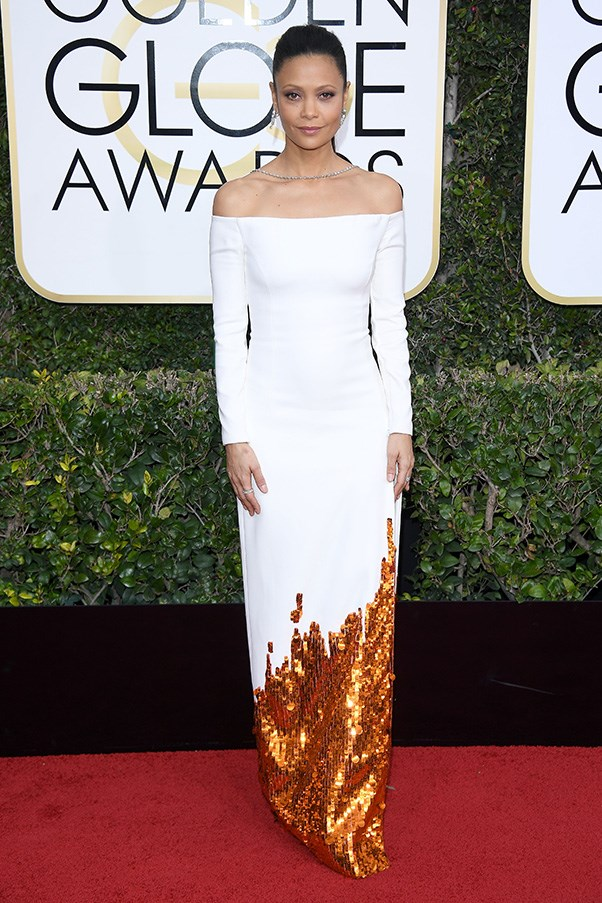 """<strong>Thandie Newton in Monse</strong><br><br> """"Thandie is literally on fire (or is it just me who sees flames in that sequinned hemline?) in this chic Monse number. The off-the-shoulder neckline with that horizontal string of diamonds is a delight. LOVE."""" - Alison Izzo, digital managing editor<br><br> """"Thandie looks elegant-as-hell in this gown by label of the moment <a href=""""http://www.harpersbazaar.com.au/fashion/trending-now/2017/1/monse-fashion-label-to-know/"""">Monse</a>."""" - Grace O'Neill, acting digital fashion editor"""