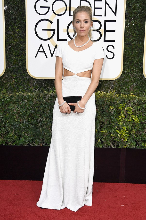"""<strong>Sienna Miller in Michael Kors Collection</strong><br><br> """"I'm sorry to say it but Sienna's look doesn't float my boat. Maybe it's because I have such high expectations of her. Or maybe it's down to that distractingly matching pearl necklace/bracelet combo. Either way, not her best. Good thing there's plenty more red carpet events to come.""""  - Alison Izzo, digital managing editor"""