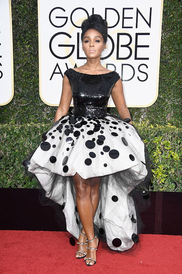 """<strong>Janelle Monae in Armani</strong><br><br> """"Not for me."""" - Karla Clarke, senior fashion editor<br><br> """"I can't quite pinpoint why this is so wrong but I'm pretty sure that oddly shaped white skirt covered in tulle and actual polka dots has something to do with it."""" - Grace O'Neill, acting digital fashion editor"""