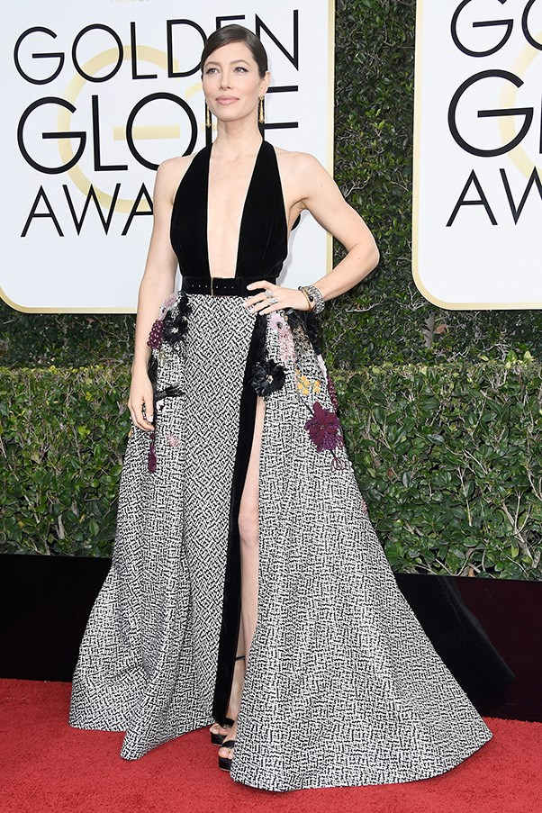 """<strong>Jessica Biel in Elie Saab Couture and Salvatore Ferragamo shoes</strong><br><br> """"This is how you show a lot of skin with style! Jessica Biel's Elie Saab Couture gown is heaven with that deep-v black velvet bodice and checkerboard print full skirt with sequins and floral embellishment. Even that Ferragamo shoe is fab. Tick, tick."""" - Kellie Hush, editor-in-chief"""