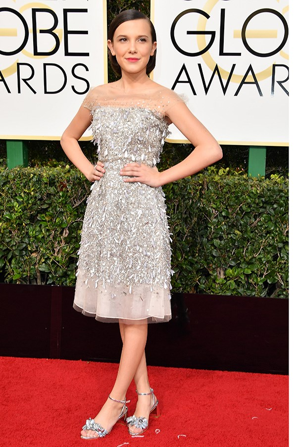"""<strong>Millie Bobby Brown in Jenny Packham and Sophia Webster shoes</strong><br><br> """"How does a 12 year old look so damn chic? A a bedazzled Jenny Packham cocktail frock helps, obviously. But she also looks totally at-ease, and age-appropriate. Extra points for the subtle lip colour and block-heel sandals.""""  - Alison Izzo, digital managing editor<br><br> """"Great name, great show, great outfit. As light, perfect and refreshing as a sorbet served atop a skyscraper."""" - Tom Lazarus, chief subeditor<br><Br> """"Well played, and I actually love those shoes. My hope for her is a Michelle Williams trajectory."""" - Karla Clarke, senior fashion editor <br><br> """"Remember the time a 12-year old slayed the red carpet? The dress is heaven, the shoes are perfection and for me this was the outfit I was most impressed with – age appropriate and still across-the-board inspirational."""" - Eliza O'Hare, travel and culture editor <br><br> """"I am the biggest <em>Stranger Things</em> fan, Eleven will always be my number 1. The dress and shoes are an adorable pairing and so age appropriate."""" - Caroline Tran, market editor"""