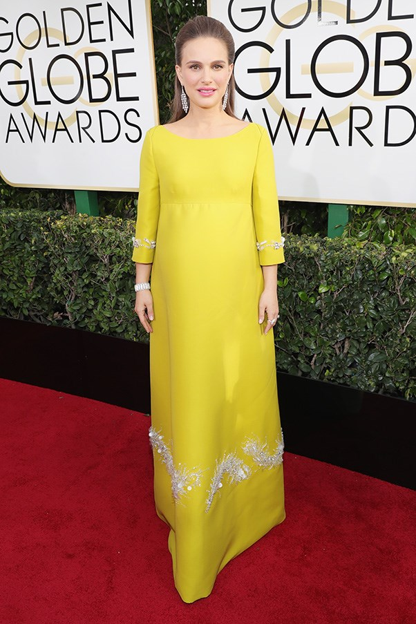 """<strong>Natalie Portman in Prada</strong><br><br> """"HEAVEN. Reigning queen of the red carpet. Also there's something to be said for dressing like you've won an Academy Award, even at the Globes."""" - Karla Clarke, senior fashion editor<br><br> """"I'm all about the colour, silhouette and fabric. I love how this sits on her tiny baby bump body."""" - Caroline Tran, market editor <br><br> """"If you looked up 'how to do the awards while pregnant' you'd see this picture of Natalie - the dress is heavenly on her. Tiny tweak? Part the hair in the middle and slick it behind her ears for a slightly less Marie-Antoinette do."""" - Anna Lavdaras, beauty writer <br><br> """"Portman, Prada, pregnancy = the holy trinity of red carpet fashion."""" - Clare Maclean, executive editor"""