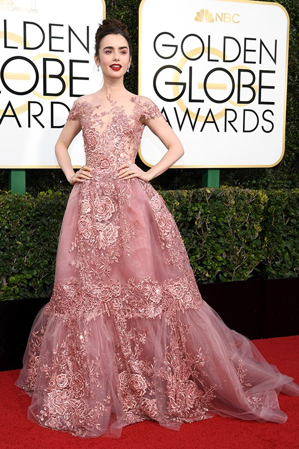 """<strong>Lily Collins in Zuhair Murad</strong><br><br> """"Lily Collins looks like she's dropped straight out of a fairytale and onto the red carpet in this ethereal rouge lace number. Absolutely stunning."""" - Natasha Harding, digital fashion writer<br><br> """"My favourite look of the lot. Usually I'm conflicted with either beauty or outfit, but Lily has pared the two effortlessly."""" - Anna Lavdaras, beauty writer<br><br> """"She's a really beautiful girl, I fear this is just too much."""" - Karla Clarke, senior fashion editor<br><br> """"Another Murad dress, another total showstopper. As my auntie texted in all caps on Christmas Day, COULD NOT HAVE CHOSEN BETTER."""" - Tom Lazarus, chief subeditor"""