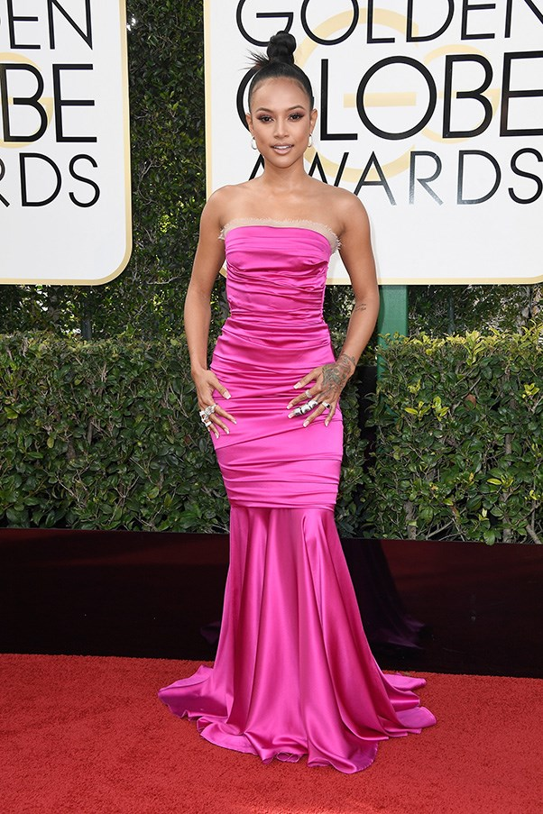 """<strong>Karrueche Tran</strong><br><br> """"Well this is awkward…"""" - Anna Lavdaras, beauty writer<br><br> """"Hot pink ruched satin is nobody's friend, and this dress is doing unkind things to Tran's otherwise fantastic figure. It kind of looks like she was going to da club, but then added a mermaid-train to make it red-carpet approps. Which it still is not."""" - Alison Izzo, digital managing editor"""