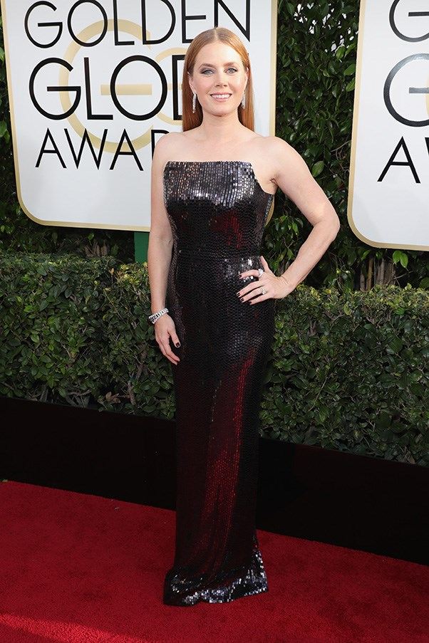 """<strong>Amy Adams in Tom Ford</strong><br><br> """"Amy Adams is a beautiful woman but this shiny black gown is definitely not her best look. The narrow train and harsh neckline are not particularly flattering and makes her appear slightly out-of-proportion (which she is not). It's a 'no' from me."""" - Natasha Harding, digital fashion writer<br><br> """"Without sounding like a '50 housewife, she needs to get her colours done. She looks beautiful and the dress is divine but I fear she pales (quite literally) in comparison to it."""" - Karla Clarke, senior fashion editor"""