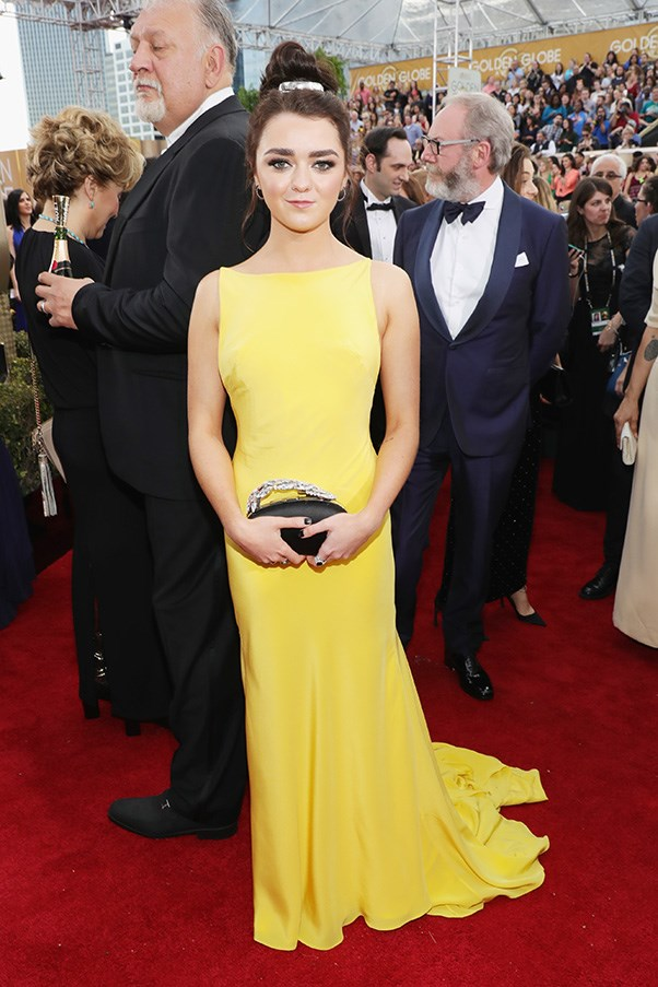 """<strong>Maisie Williams</strong><br><br> """"I'm not sure how Williams manages to look sassy while also sporting a prom-tastic updo and a full length canary yellow gown but it's happening and I love it."""" - Clare Maclean"""