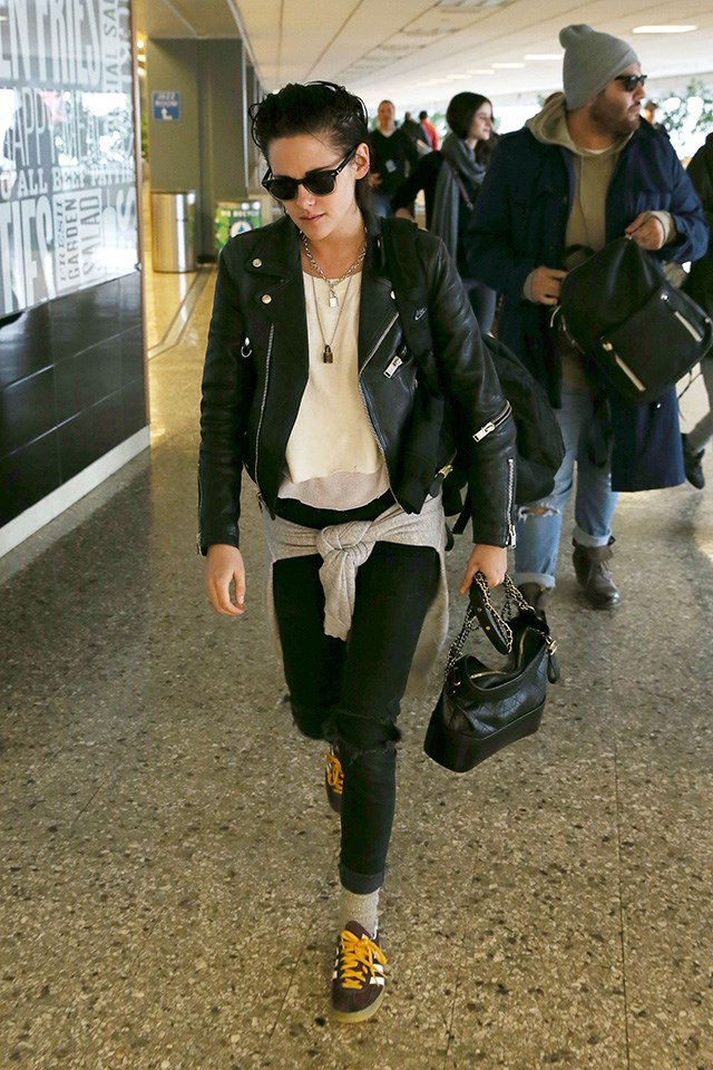 Kristen Stewart sticks to her trademark tomboy style in LAX, complete with Chanel's Gabrielle bag.