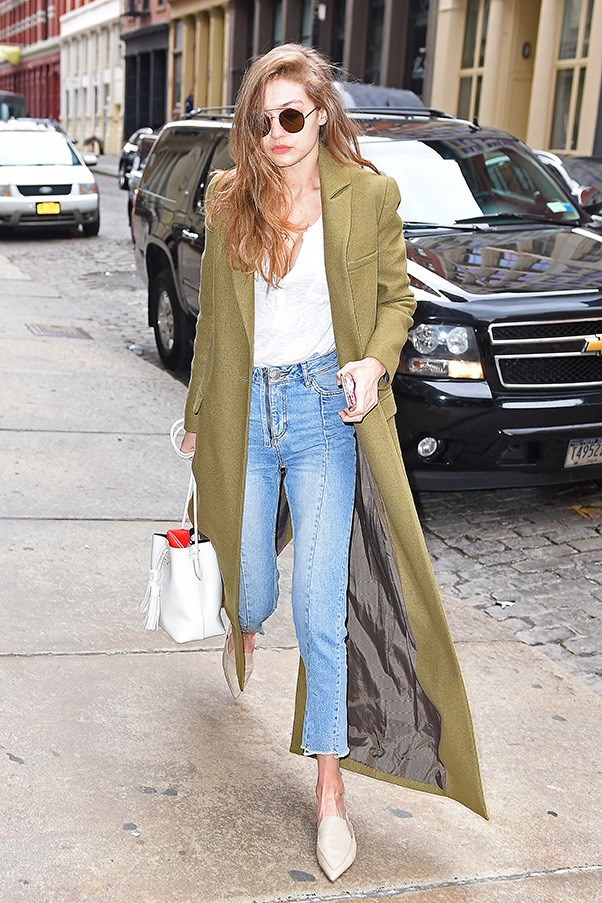 """<strong>Zimmermann</strong><br><br> Gigi Hadid stepped out in New York wearing a khaki duster coat by Zimmermann.<br><br> Shop the coat (on sale!) <a href=""""https://www.zimmermannwear.com/karmic-coat-fennel.html"""">here</a>."""
