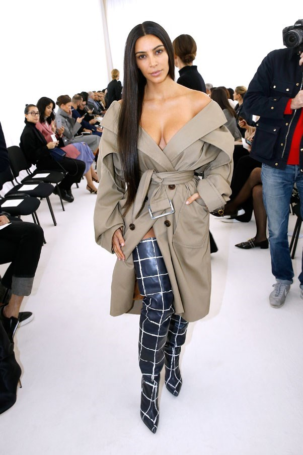 <strong>October 2nd, 2016</strong><br><br> Kim wore a Balenciaga trench coat and thigh-high boots to the brand's spring summer '17 show.