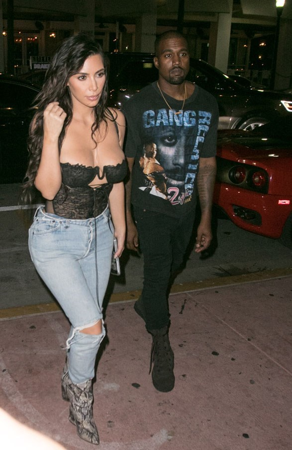 <strong>September 15th, 2016</strong><br><br> Kim wore high-waisted ripped jeans with a sheer bustier out in Miami with husband Kanye West.