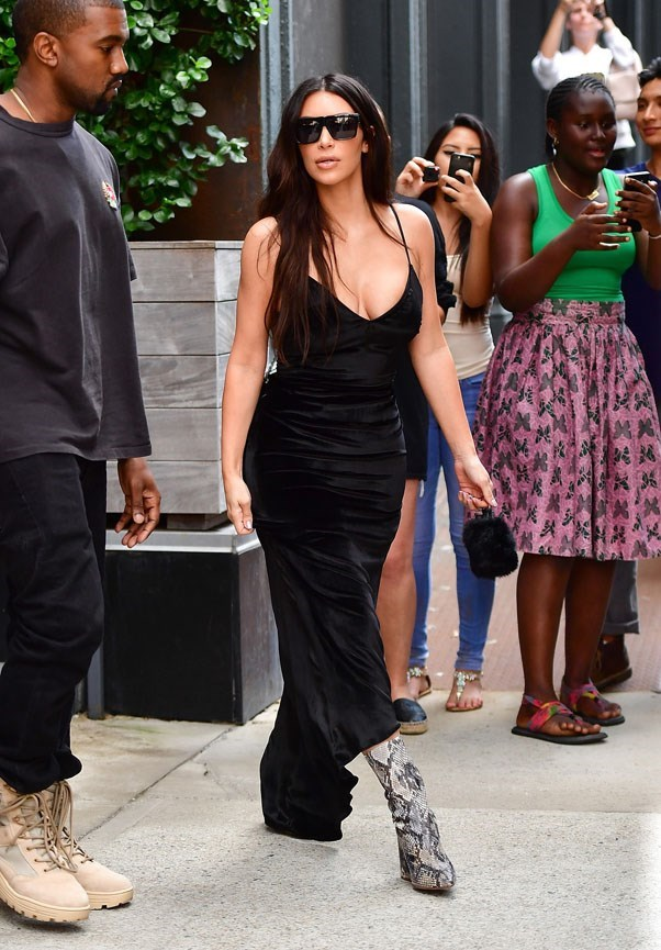 <strong>September 14th, 2016</strong><br><br> Kim rocked head-to-ankle black and crocodile skin ankle boots while out and about in New York city.