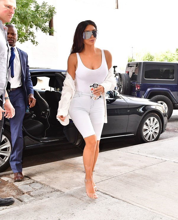 <strong>September 2nd, 2016</strong><br><br> Kim wore a white bodysuit, knee-length denim and Yeezy perspex heels out and about in New York City.