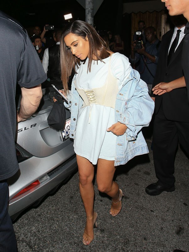 <strong>August 1st, 2016</strong><br><br> Kim wore a corset bralette over an oversized white tee and Yeezy perspex heels while out and about in New York City.