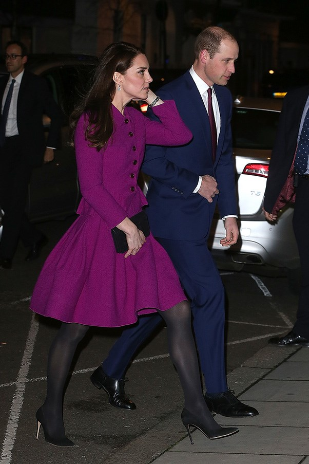 The Duchess opted for a purple skirt suit while at the Guild of Health Writers Conference with husband Prince William.