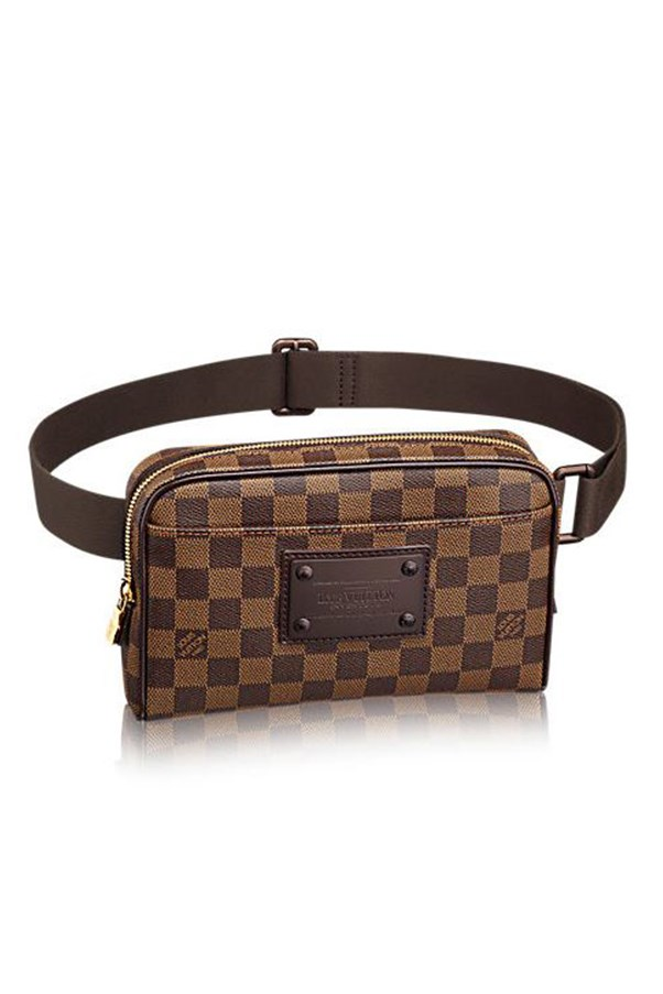 """The ultimate Pussy Grabber-proof accessory, this Louis Vuitton bum bag acts as a kind of designer chastity belt while ensuring you're the only one touching anything in or around your nether regions. <br><br> Bum bag, price on request, <a href=""""http://ca.louisvuitton.com/eng-ca/products/bum-bag-brooklyn-damier-ebene-000056"""">Louis Vuitton</a>."""