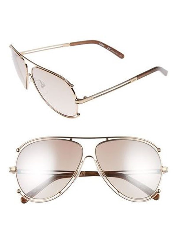 """Thanks to Gloria Steinem—whose signature sunglasses have accompanied her everywhere from the feminist movement of the 1970s to this year's Women's March in Washington, D.C.—we have proof that donning a pair of gold-trimmed, graduated-lens aviators makes you a massive legend. <br><br> Aviator sunglasses, $449, Chloé at <a href=""""https://www.farfetch.com/au/shopping/women/chloe--isadora-sunglasses-item-11688526.aspx?storeid=9945&size=17&origin=product-search&bfdqbt=&source=pla&gclid=CjwKEAiAoOvEBRDD25uyu9Lg9ycSJAD0cnBy4TFHxdgy6ey2l7PpCtL3BpG5rILukpk4B-QYizgeGBoCrYjw_wcB&gclsrc=aw.ds"""">Far Fetch</a>"""