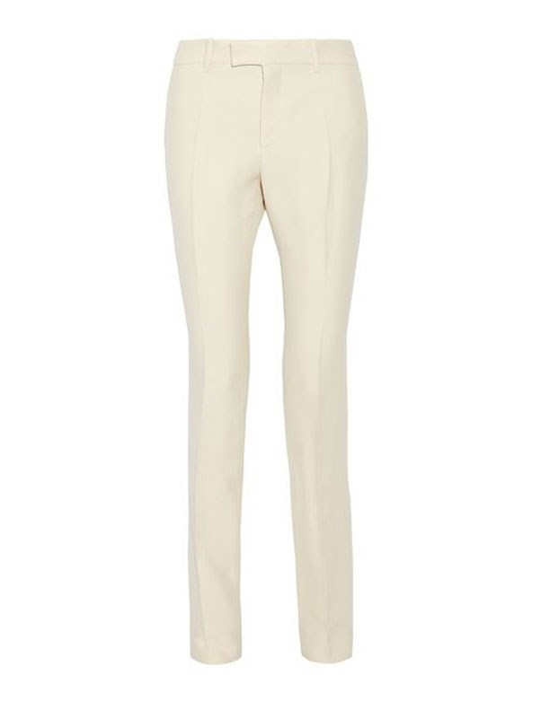 """Hillary may not have been elected, but her signature pantsuit reigns supreme in our wardrobes. Because nobody means business like a woman in colour-coordinated separates. <br><br> Straight-leg pants, $1,200, Gucci at <a href=""""https://www.net-a-porter.com/au/en/product/757453/gucci/wool-and-silk-blend-faille-straight-leg-pants"""">Net-a-Porter</a>"""