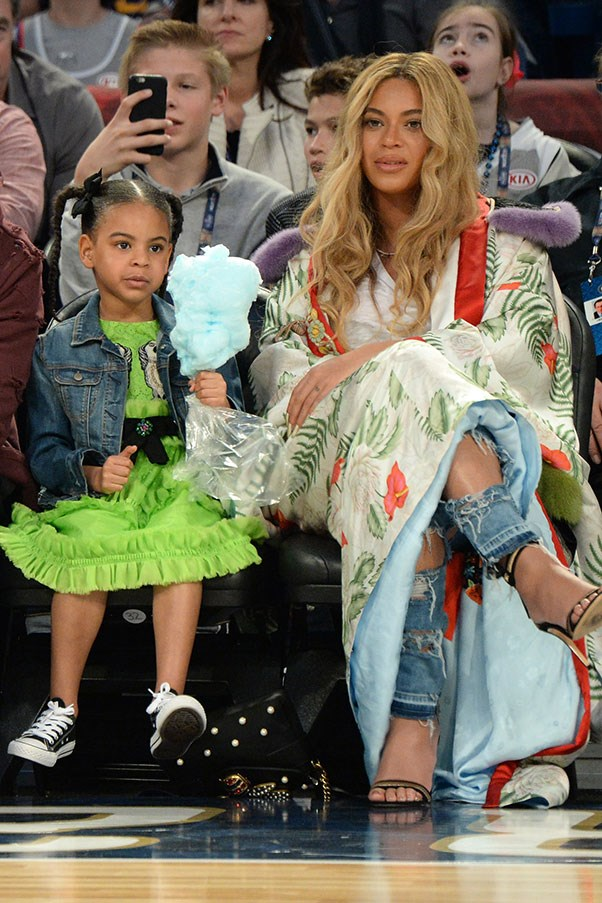 Pregnant-with-twins Beyoncé rocked an incredible floor-length Gucci kimono with ripped jeans and sandals to attend the NBA All-Star game with daughter Blue Ivy (also in custom Gucci, obvs) and husband Jay Z.