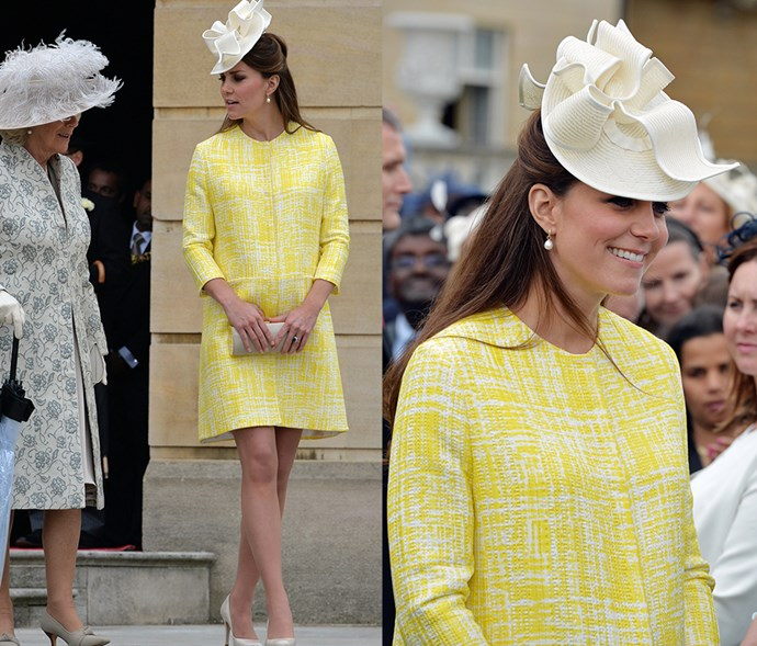 <em>Yellow</em> <p> Although her hat technically isn't in the same shade of bright lemon as her coat-dress, we think she still gets a pass for the delicate cream shade.