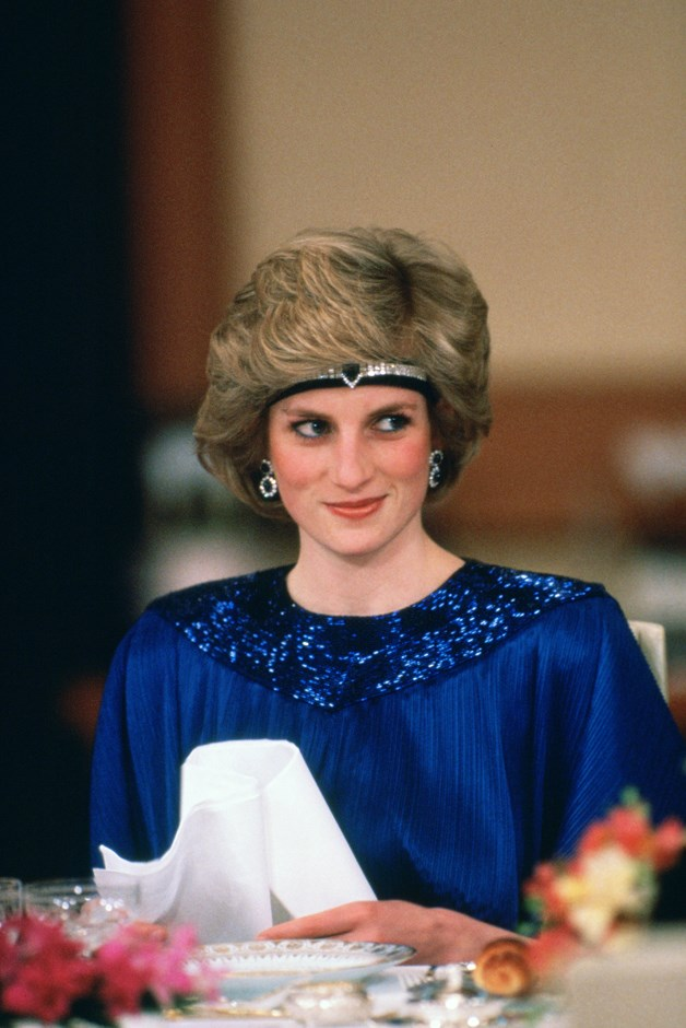 Wearing a diamond and sapphire choker from the Queen's Saudi Arabian sapphire and diamond suite as a bandeau in 1986.