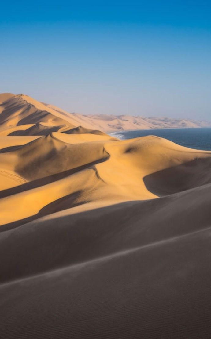 <p><strong>Walvis Bay, Namibia</strong> <p>The massive sand dunes alone are reason to book a trip to Walvis Bay. But you'll also want to come to this beach on Namibia's Skeleton Coast for the wildlife—you're likely to spot flamingos, seals, whales and even hyenas here.