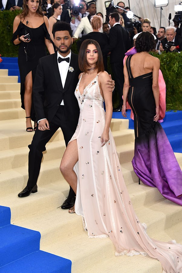 The Weeknd and Selena Gomez in Coach and Tiffany & Co. jewellery