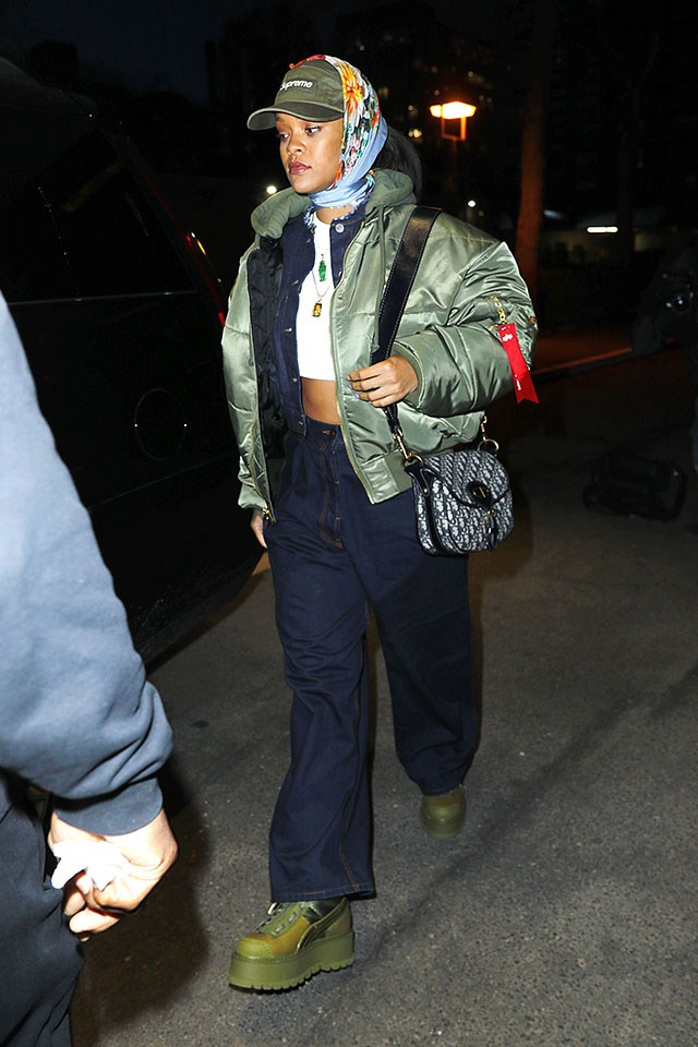 <strong>When:</strong> 23 March 2017 <br><br> <strong>What:</strong> A Supreme baseball cap, silk scarf, olive puffer jacket over a denim jacket, Fenty x Puma boots and a Christian Dior bag in New York City.