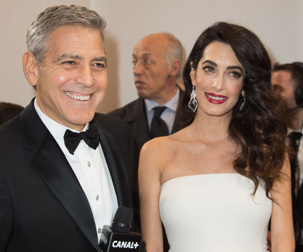 George, Amal Clooney with twins arriving in Milan