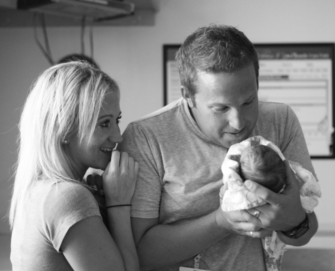 Adoptive Mum and Dad meet their baby for their first time in viral photographs