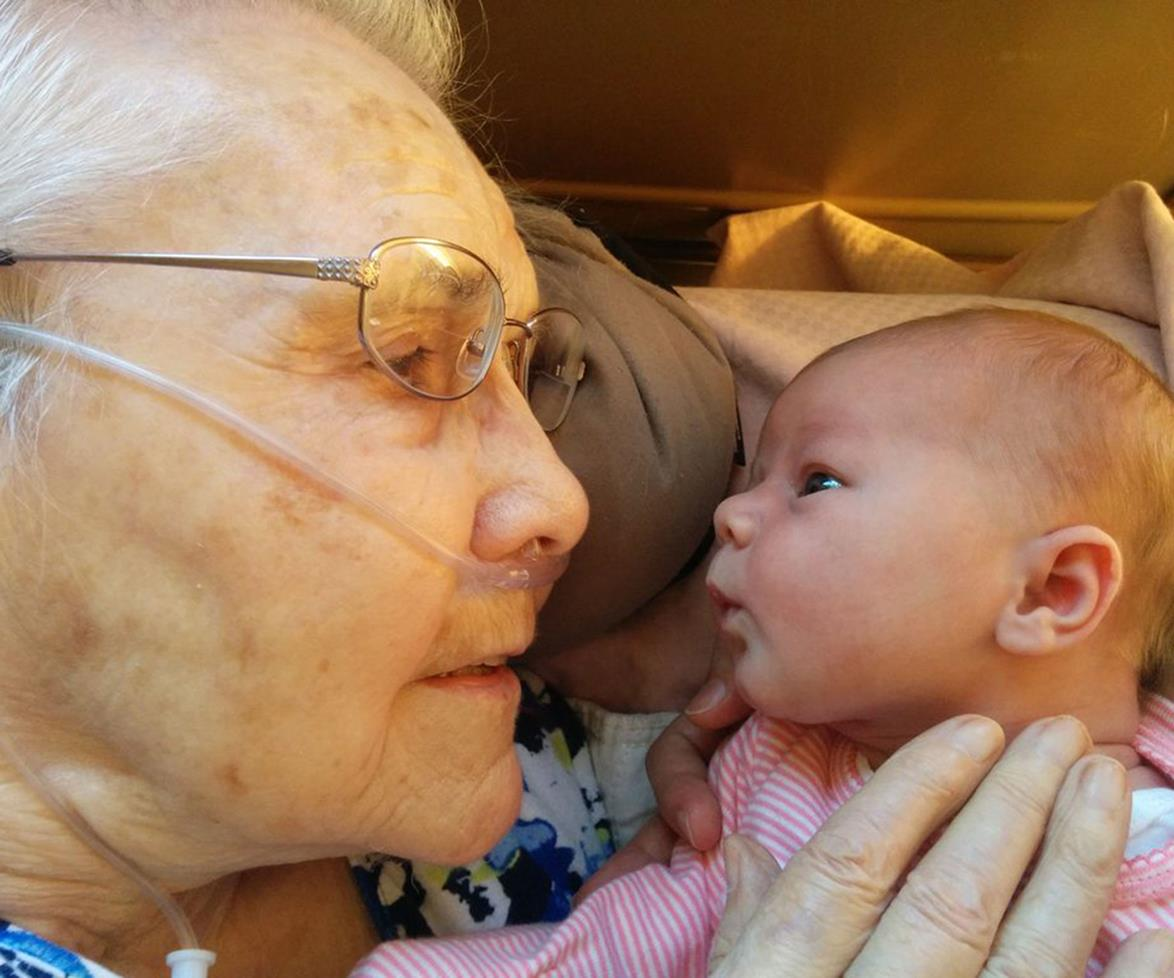 Newborn meets great grandmother for first time