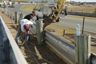 The old Armco fence being dismantled