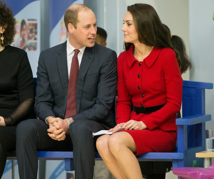 """How lovely! Kate and Wills sit atop the """"kindness bench"""" as they hear stories of the students many acts of kindness."""