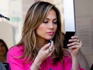 J-Lo applying lipstick