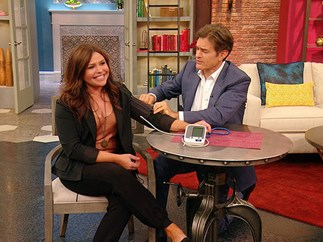 Woman having blood pressure checked by Dr Oz