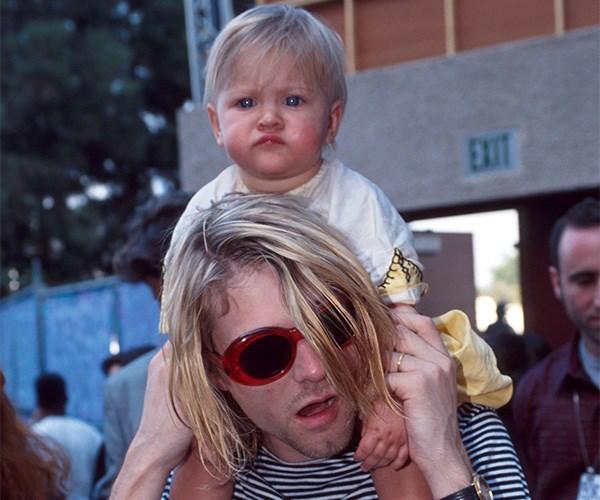 Frances Bean Cobain with her dad Kurt Cobain.