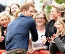 Harry hunters unite: The Prince is mobbed on his latest outing
