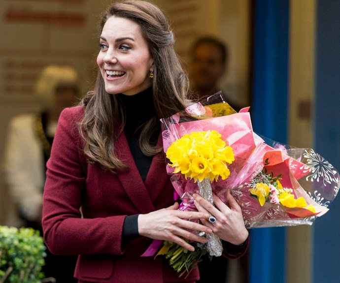 New pics: Duchess Kate meets families and plays pool during visit to a children's charity