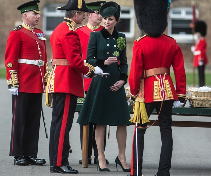 Kate looked stunning in the emerald green, double-breasted coat designed by Catherine Walker. It is a bespoke piece.