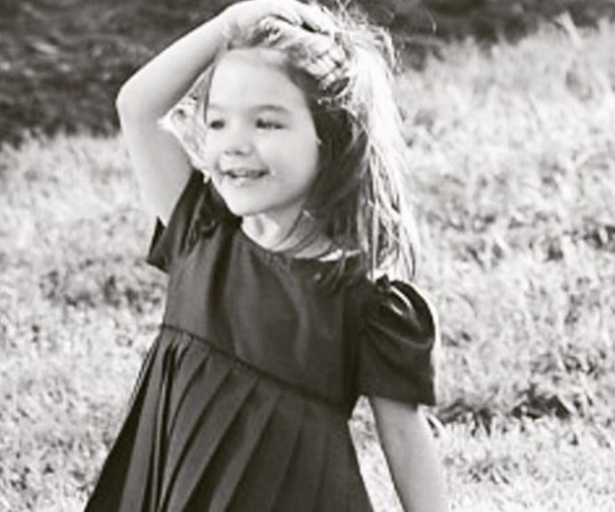 """Katie Holmes took to Instagram to share an adorable (and very rare) photo of her """"sweet angel"""" daughter, Suri Cruise. In the throwback snap, Suri – now 10 – looks exactly like her mummy and we just can't get enough of that darling smile."""