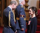 Victoria Beckham receives OBE from the Duke of Cambridge at Buckingham Palace