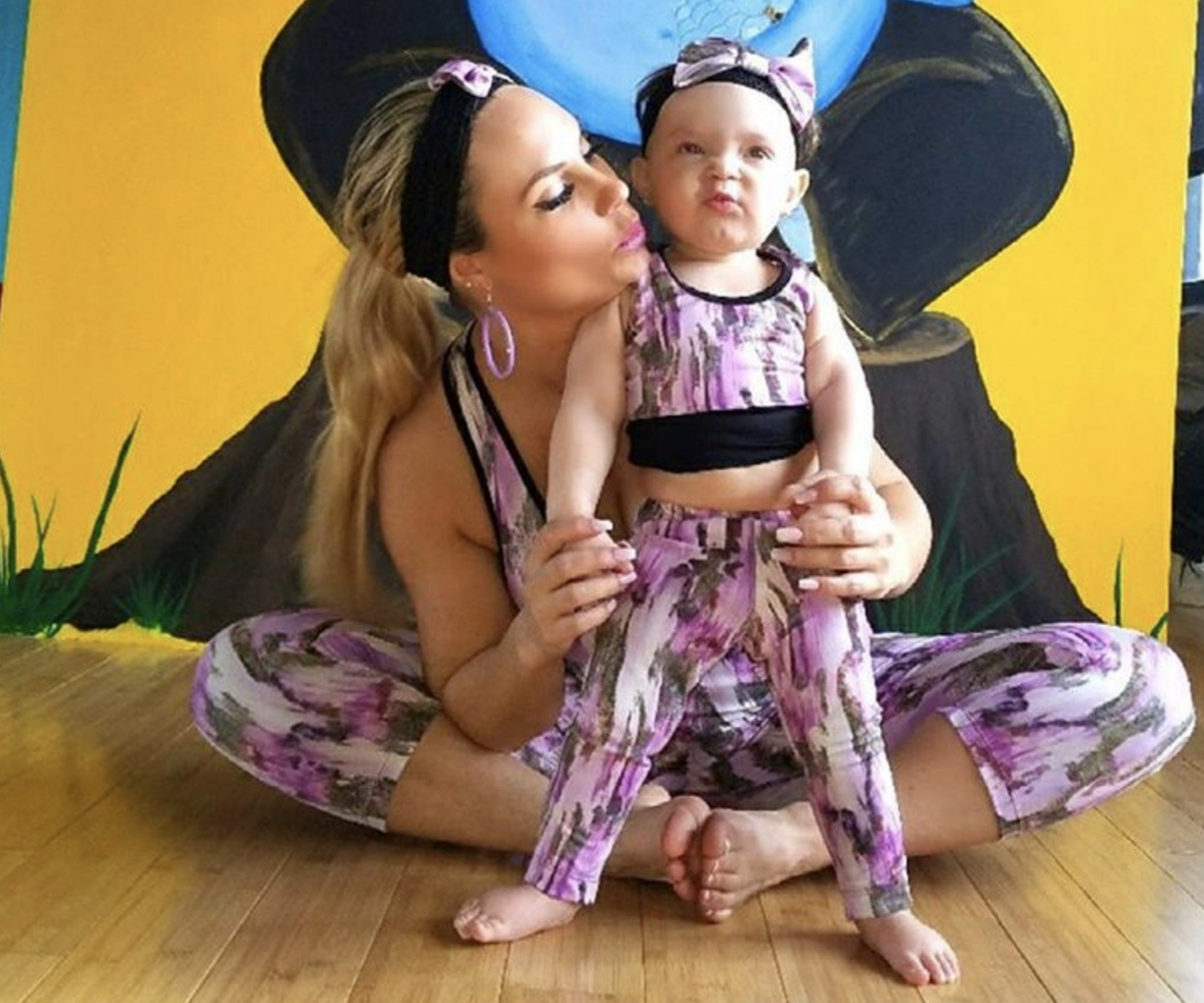 """Coco Austin's and her one-year-old daughter, Chanel, have started working out together… in matching outfits! The actress-dancer posted a sweet snap of the mother-daughter moment on Instagram, writing, """"Mummy-and-me yoga class!"""" Cute!"""