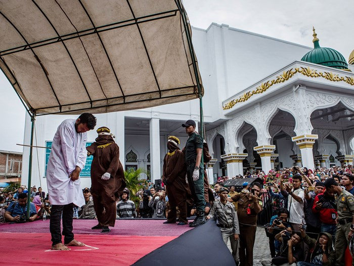Men publicly caned 83 times for gay sex