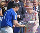 Queen Elizabeth is a floral dream at the polo, despite 'heatwave'