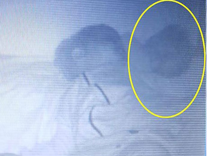 "Mum shares photos of a ""ghost baby"" snuggling up next to her sleeping toddler"