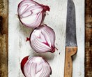 Why does chopping onions make you cry and how do you make it stop?
