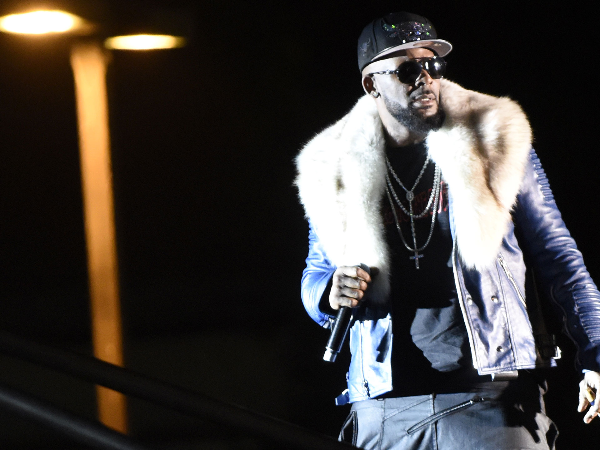 R&B singer R. Kelly denies holding women captive