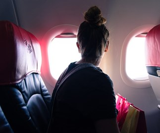 This woman's flight was ruined by two unwanted guests