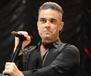 The crippling condition to blame for Robbie Williams' bad diet