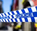 A man has been charged after allegedly setting alight a woman in Brisbane's north
